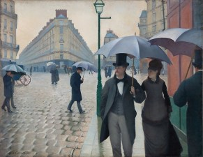 Fashionable people stroll along rainy Paris street holding umbrellas Paris Street; Rainy Day, 1877 Gustave Caillebotte