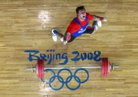 BEIJING - AUGUST 18: Dmitriv Klokov of Russia celebrates a lift en route to winning the silver medal in the Men's 100KG Weightlifting Competition during Day 10 of the Beijing 2008 Olympic Games on August 18, 2008 in Beijing, China. (Photo by Donald Miralle)