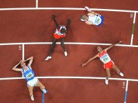 BEIJING- AUGUST 19: (L-R) Christian Obrist of Italy, Belal Mansoor Ali of Bahrain, Andy Baddeley of Great Britain and Rashid Ramsi of Bahrain collapse at the finish line in the Men's 1500M Final during day 11 of the Beijing Summer Olympic Games on August 19, 2008 at the National Stadium in Beijing, China. Ramsi won the gold medal. (Photo by Donald Miralle)