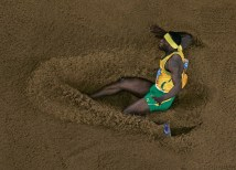 ATHENS - AUGUST 26: James Beckford of Jamaica competes during the men's long jump final on August 26, 2004 during the Athens 2004 Summer Olympic Games at the Olympic Olympic Stadium in the Sports Complex in Athens, Greece. (Photo by Donald Miralle/Getty Images)