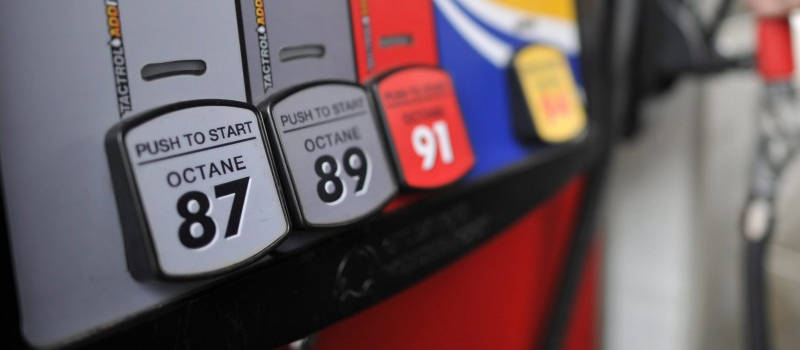 Close up photograph of fuel pump at a gas station displaying the different octane grades available.