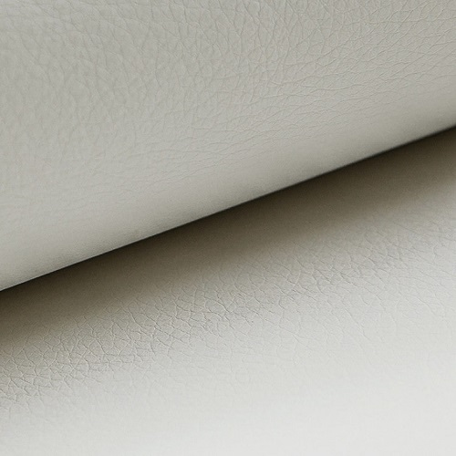 White faux leather of the small corner sofa Brighton