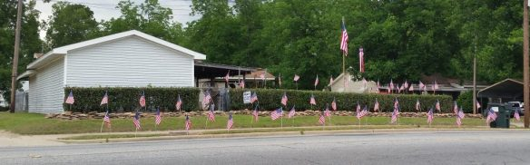 Home with American Flags Displayed for Memorial Day