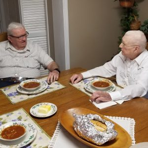 Two WWII Vets talking and eating soup