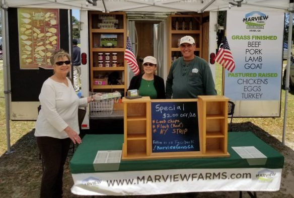 Woman buying eggs from Marview Farms
