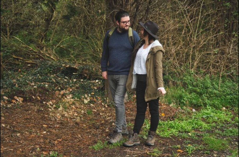 Wesley and partner walking through some woods