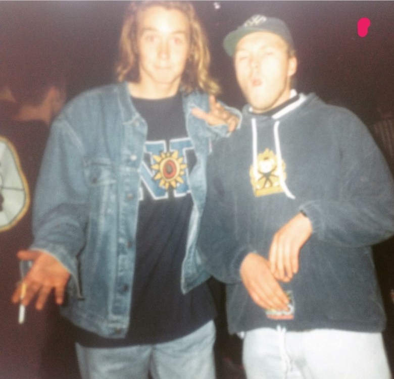 An image of Andy Maddison and friend in the height of Acid House, wearing denim jackets and hoodies and jeans.