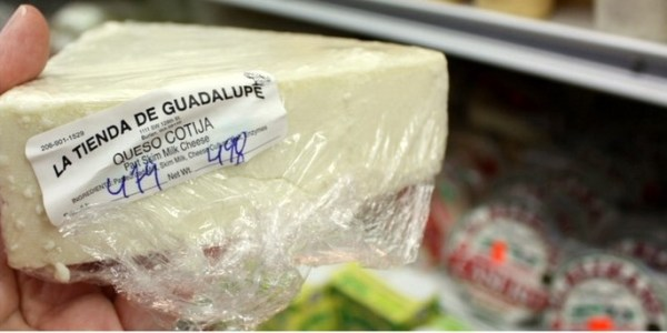 Cotija is a hard, strong cheese that is crumbled on top of many different dishes.