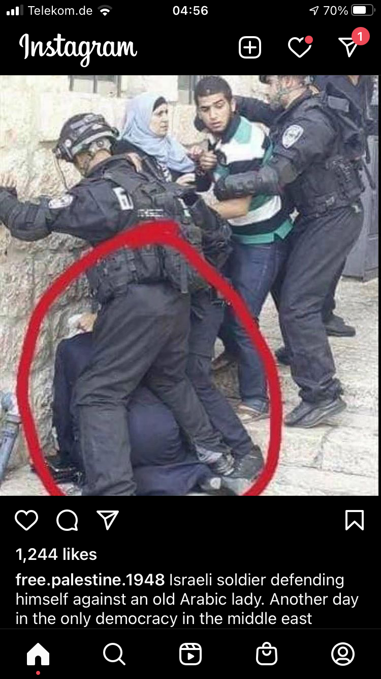 Israeli Soldier Defending Himself Against an Old Arabic Lady
