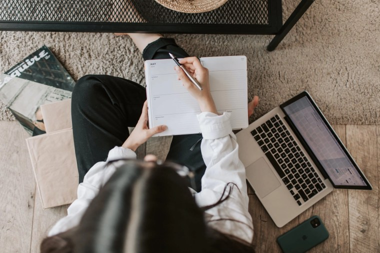 faceless lady with notebook and laptop on floor at home/companion blog