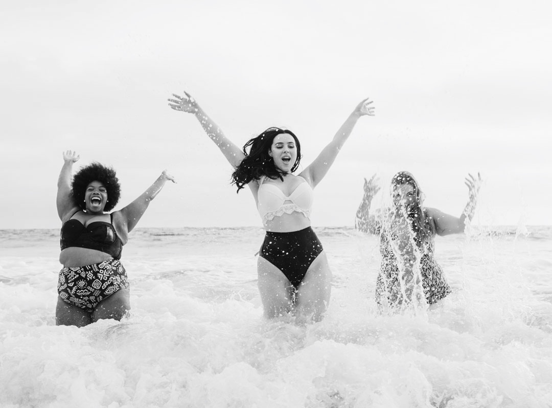 3 girls splashing in the sea, body confidence