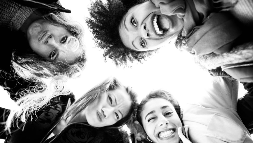 Women laughing in a circle/ friendship