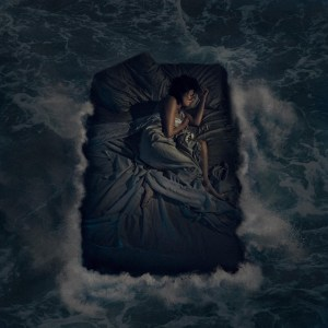 Woman asleep on bed in ocean