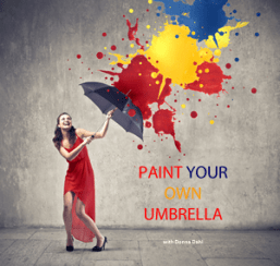 Capture the Unique Essence of You and Capitalize on Your Potential. Dream. Dare. Do. Girl holding umbrella with splashes of colour raining down