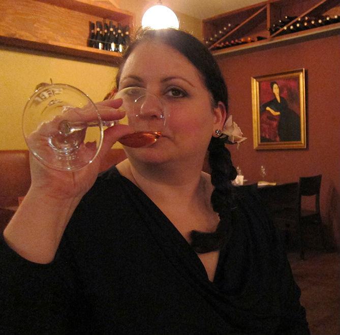Donna DeRosa Drinking Champagne