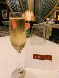 A picture of a glass of champagne from PRIME Steakhouse at the Bellagio. This is a perfect spot for a romantic evening with a loved one. We, however, only went to redeem our free champagne reward using the myVEGAS app. The champagne was bubbly and the atmosphere was beautiful.