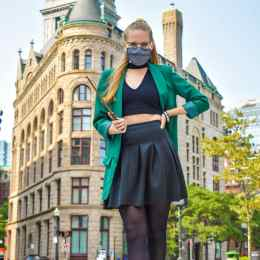 Perfect example of reusing items you own for Disney Bounds (or Harry Potter outfits!). I am reusing my green blazer from my Loki outfit to create a Slytherin look with the rest of the outfit in all black. Standing out front of a building in Boston that looks like Gringotts.