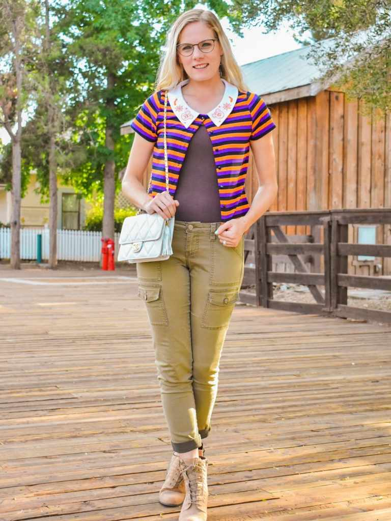 October is for Halloween - but it's also for fall colors too. So why not combine them both with this outfit featuring the striped crop top from Her Universe! I styled the shirt by only leaving the top button buttoned, a brown cami underneath, and a pair of army green skinny jeans. For a final touch of fall, I styled it with my favorite pair of brown booties.