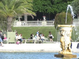 people relaxing by the fountain