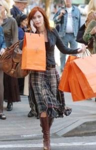 woman walking with hermes orange bags in the devil wears prada