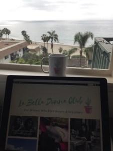 desk and computer overlooking the ocean