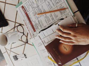 parent with homeschooling materials