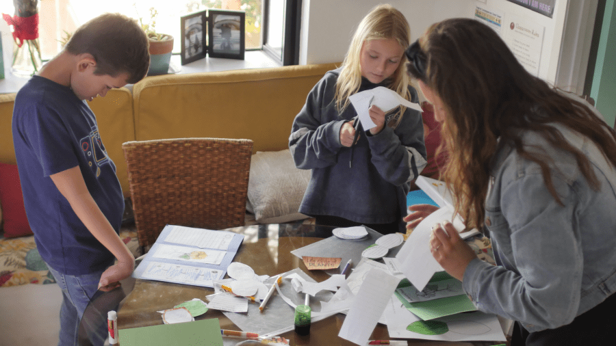 group of students and teacher doing hands-on activity in homeschool program