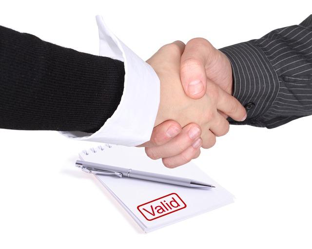 business handshake for salespeople