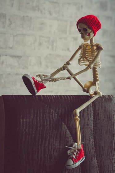 gold and red skeleton figurine