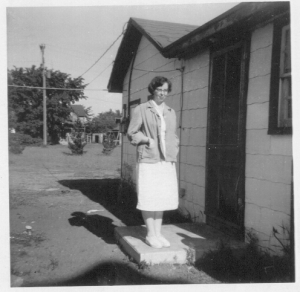 Photo of Sylvia Larson by side door of Fridley House.
