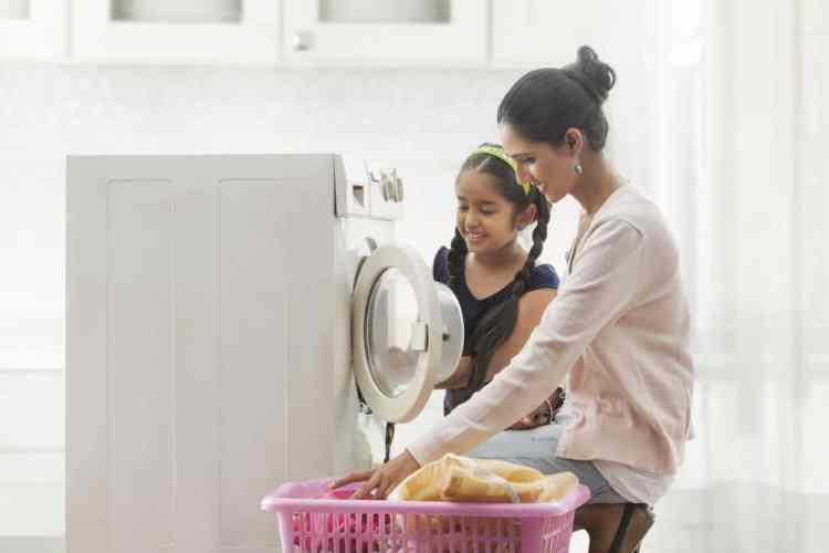 interior laundry woman child doing washing home
