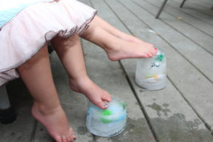 Sensory play idea: Layer and freeze small toys in recycled containers