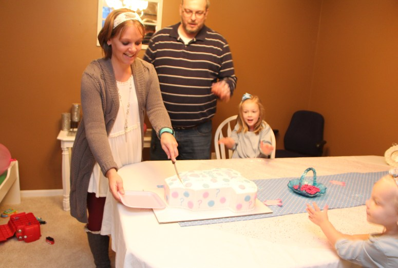 Cutting our gender reveal cake!!