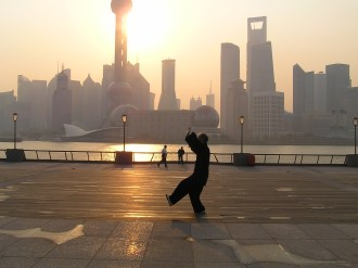 The traditional early morning tai chi with a progressive back drop