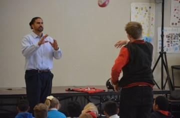 Dj Tialavea of the Atlanta Falcons speaking at West Jordan School 1