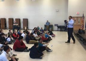 Dj Tialavea of the Atlanta Falcons speaking at West Jordan School 8