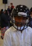 student wearing helmet after meeting Dj Tialavea of the Atlanta Falcons speaking at West Jordan School
