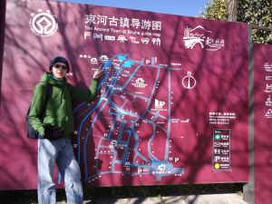 Jonny Blair at the map to Shuhe Old Town - China - a lifestyle of travel
