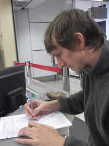 Jonny Blair filling in a Chinese Visa application living a lifestyle of travel