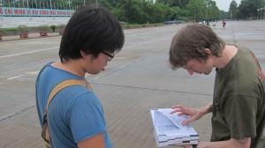 Jonny Blair living a lifestyle of travel reading travel guide books in Vietnam