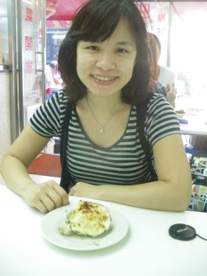 Panny the travelling Hong Kong girl in her home country enjoying cheese oysters.