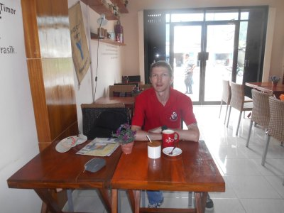 Having a $1 US coffee in Peace Coffee, Dili, East Timor.