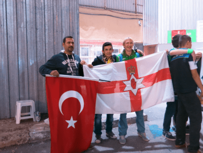 Turkey fans pose with my travelling NI flag