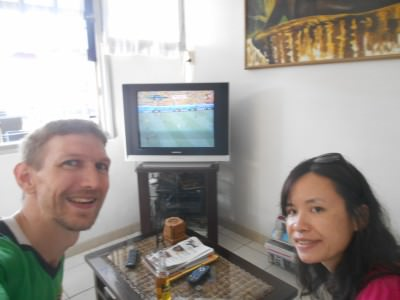 Watching Colombia get knocked out by Brazil in the TV in Guesthouse Amice reception.