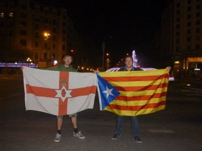 Marc and I with Northern Ireland (Ulster Banner) and Catalonia Independence flags in Barcelona.