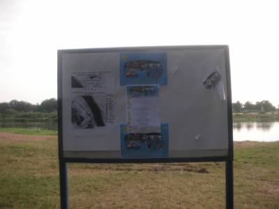 An information board by the Belshina River