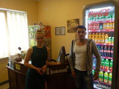 Zhenya and a customer at the Crazy Dog