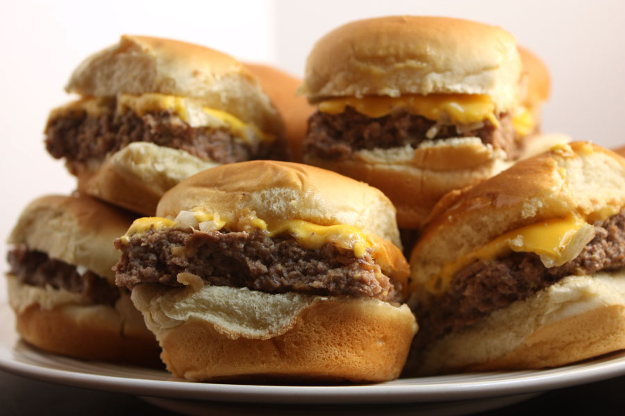 Oven Baked Sliders stacked on white plate