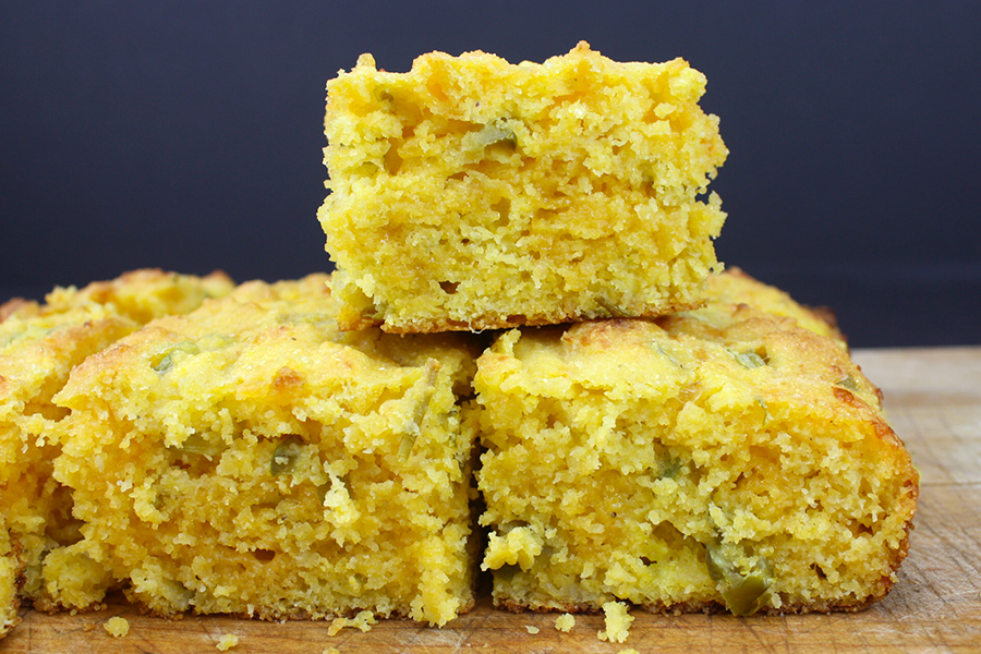 slices of cornbread stacked on a cutting board