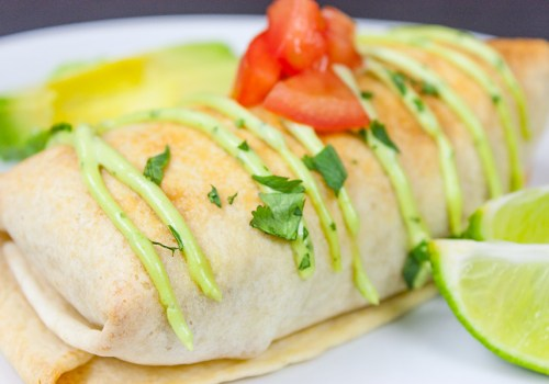 Baked Chicken Chimichangas - Crispy, healthy and filled with the best shredded Mexican chicken EVER!